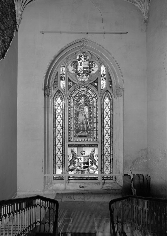 Skye, Armadale Castle, interior. General view of staircase stained glass window. Quatrefoil arms above and armed figure and further coat of arms below.
