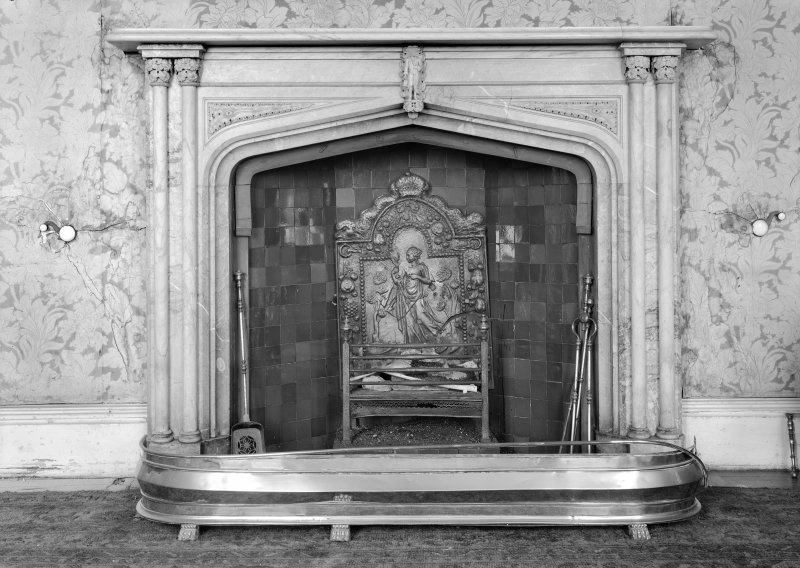 Skye, Armadale Castle, interior. Detail of dining room fire-place. Gothic design surround with cast iron fireback depicting a lady with a mirror.