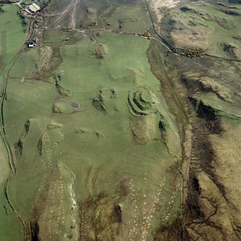Oblique aerial view centred on the remains of the fort and rig, taken from the WSW.