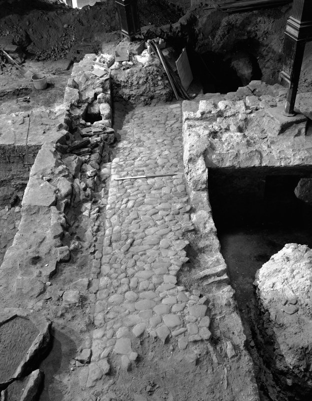 Interior-general view during excavations of cobbled wynd from N.