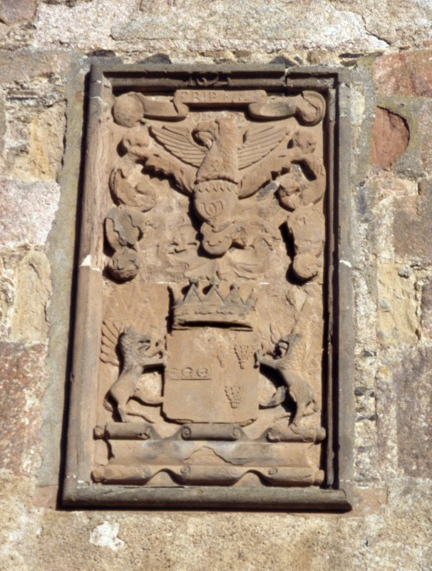 Detail of armorial panel over entrance.