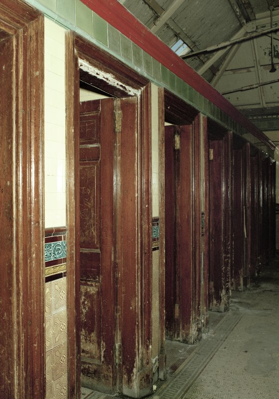 View of row of nine toilet cubicles from SE. Photosurvey 9-OCT-1991