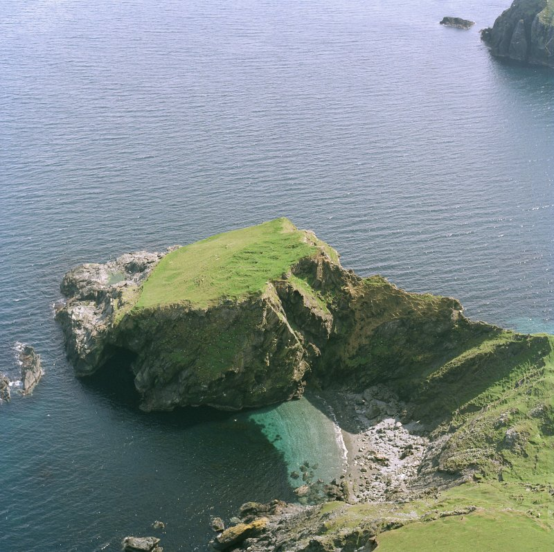 Scanned image of oblique aerial view centred on the remains of the monastic settlement, taken from the NNW.