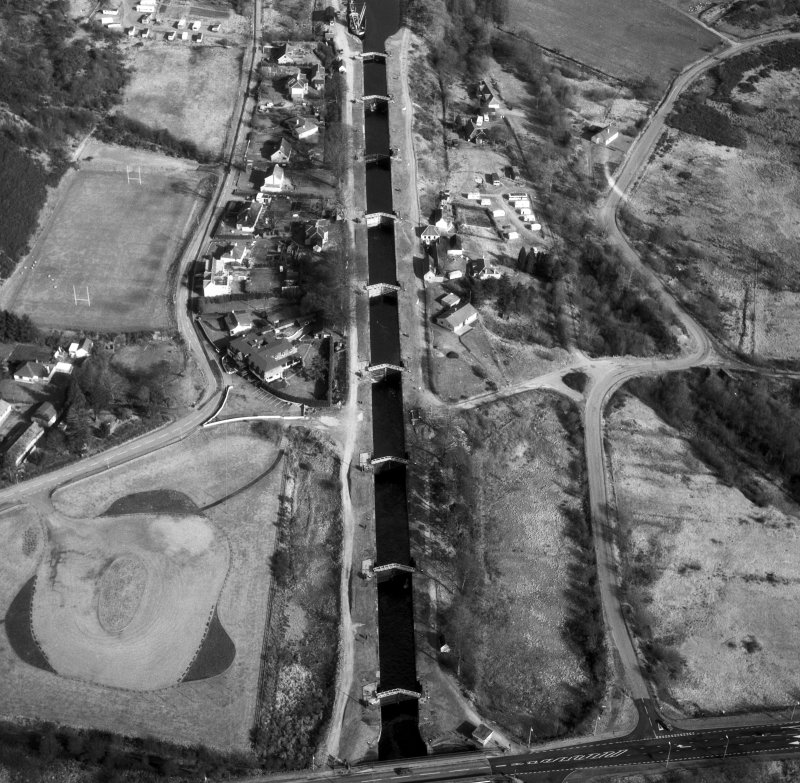 Scanned image of oblique aerial view showing Neptune's Staircase, Banavie Swing Bridge and Banavie Railway Swing Bridge