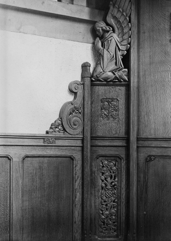 Copy of photograph showing detail of panelling with praying angel motif.