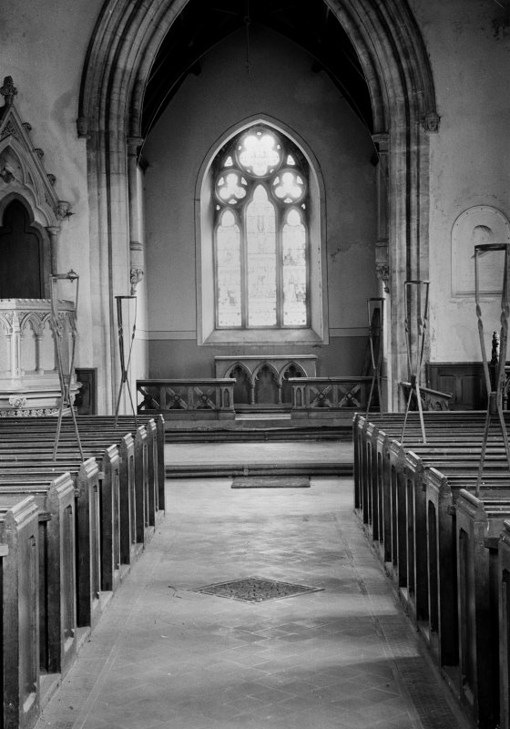 Interior. View down aisle towards E window.