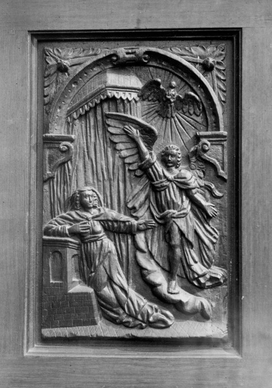 Interior. Detail of carved panel on wooden seat.