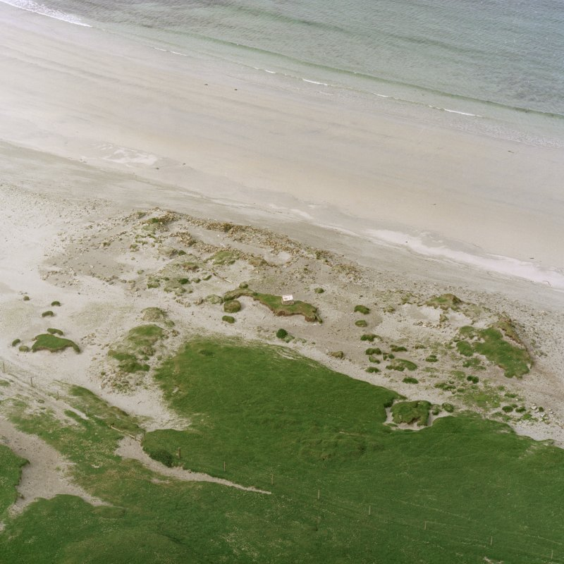 Scanned image of oblique aerial view centred on the remains of the Viking Settlement, taken from the SW.