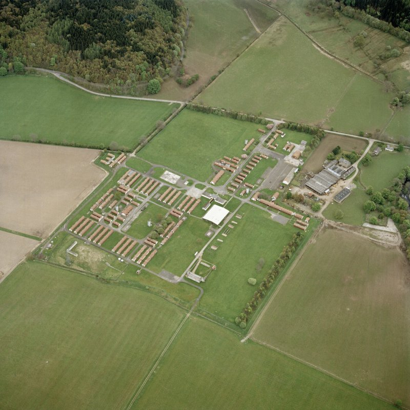 Oblique aerial view centred on the military camp with the bunker, observation post and remains of the church and graveyard adjacent, taken from the WNW.