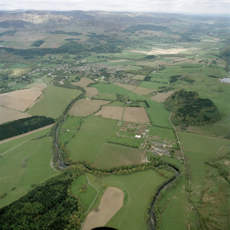 Oblique aerial view looking across the military camp and house towards Comrie, taken from the SW.