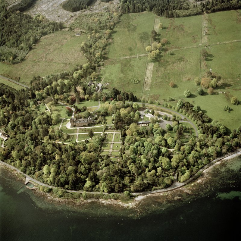 Oblique aerial view centred on the country house, walled garden and cottages, taken from the SE.