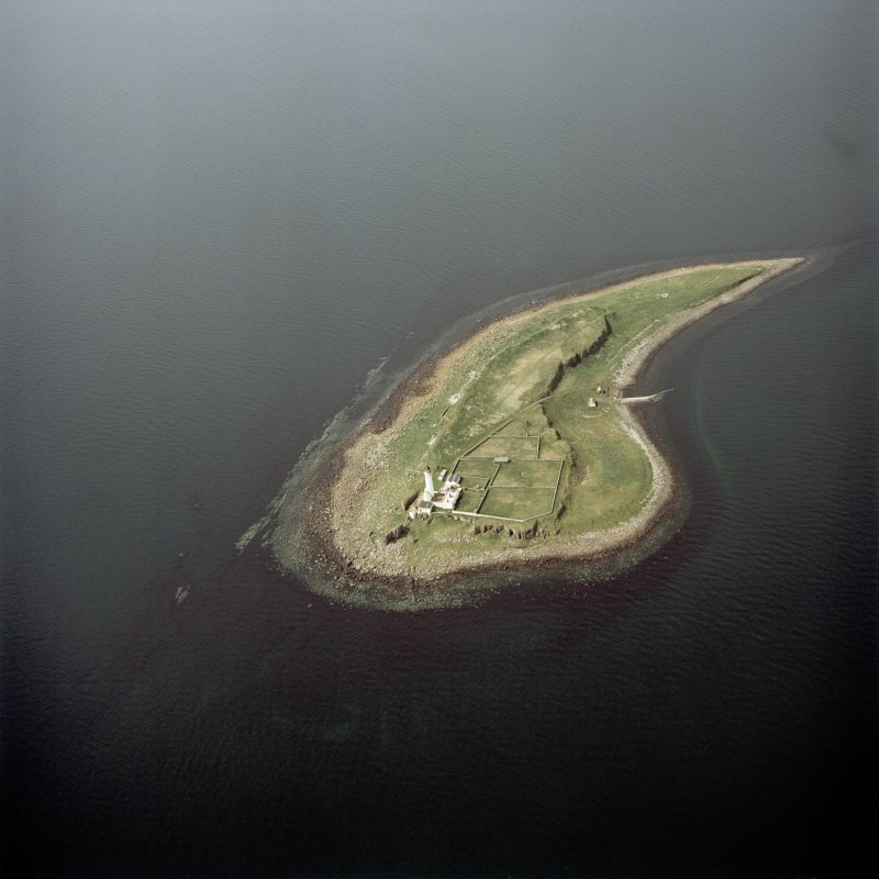 Oblique aerial view of Pladda centred on the lighthouse, taken from the SE.