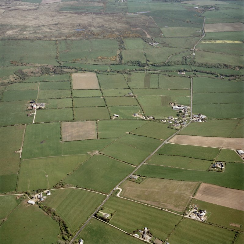 General oblique aerial view centred on the village and farmsteadings, taken from the WNW.