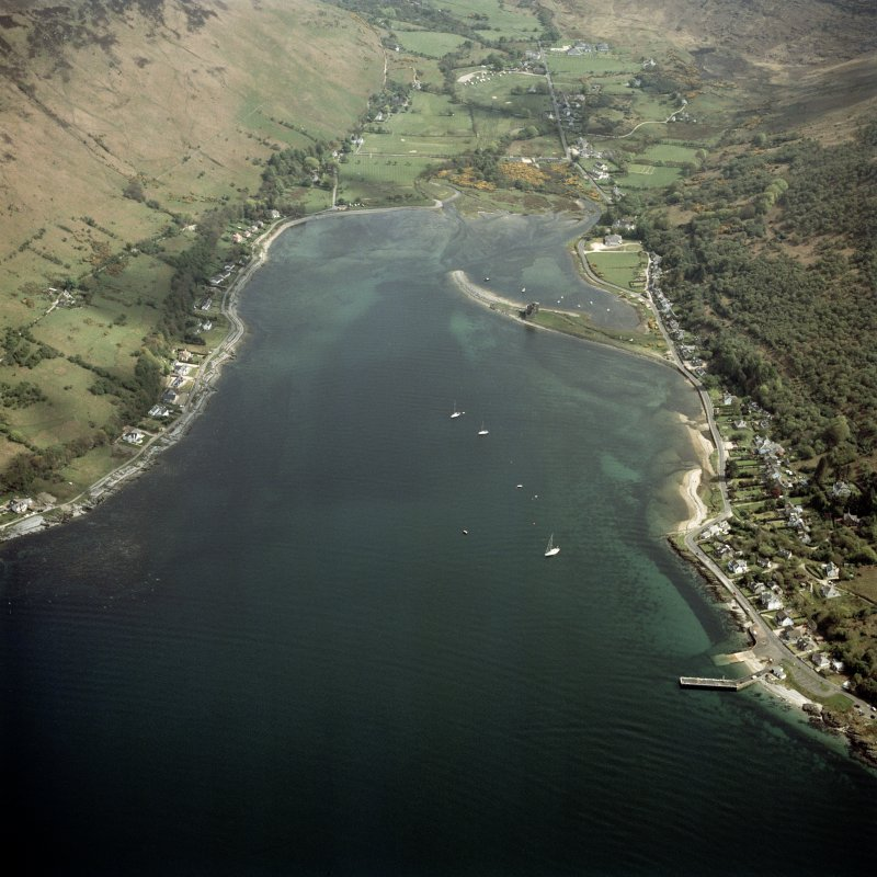 General oblique aerial view centred on Loch Ranza, the village and the remains of the castle, taken from the NW.