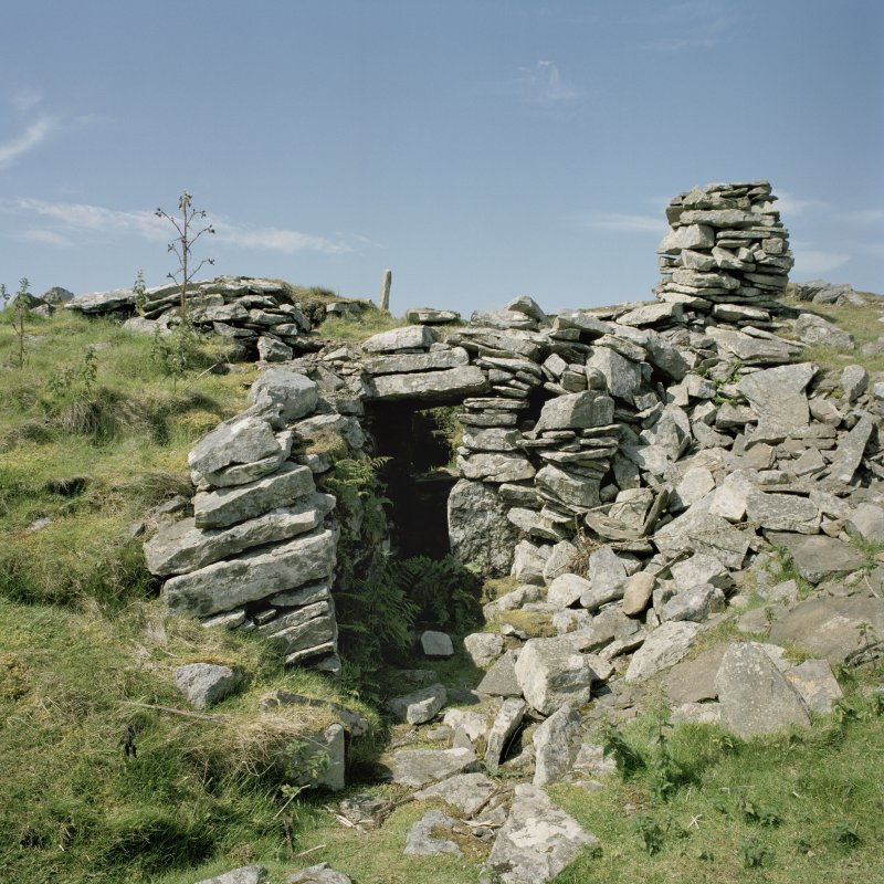 View from E of passage leading to chamber at the E end of the cairn