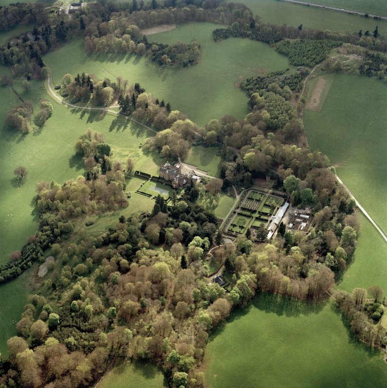 Oblique aerial view centred on the country house, taken from the ENE.