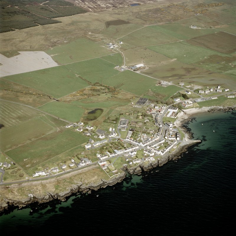Oblique aerial view centred on the village with the farmstead adjacent, taken from the SSE.