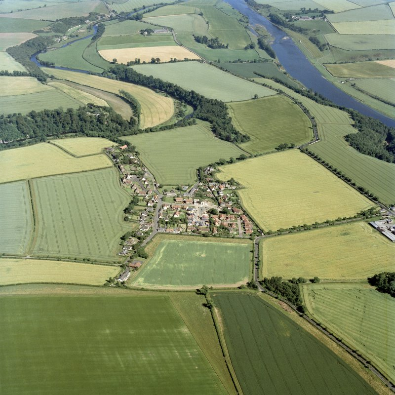General oblique aerial view centred on the village, taken from the WNW.