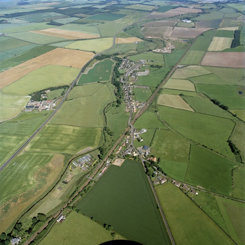 General oblique aerial view looking across the village towards the village of Ayton, taken from the W.