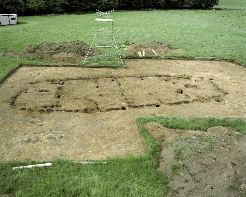 Site under excavation. Hi-spy view from SE with ranging poles.