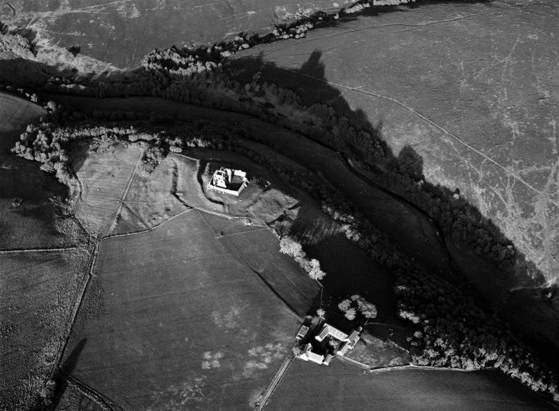 Oblique aerial view centred on the remains of the fort and tower house at Auchindoun Castle, looking to the ENE.