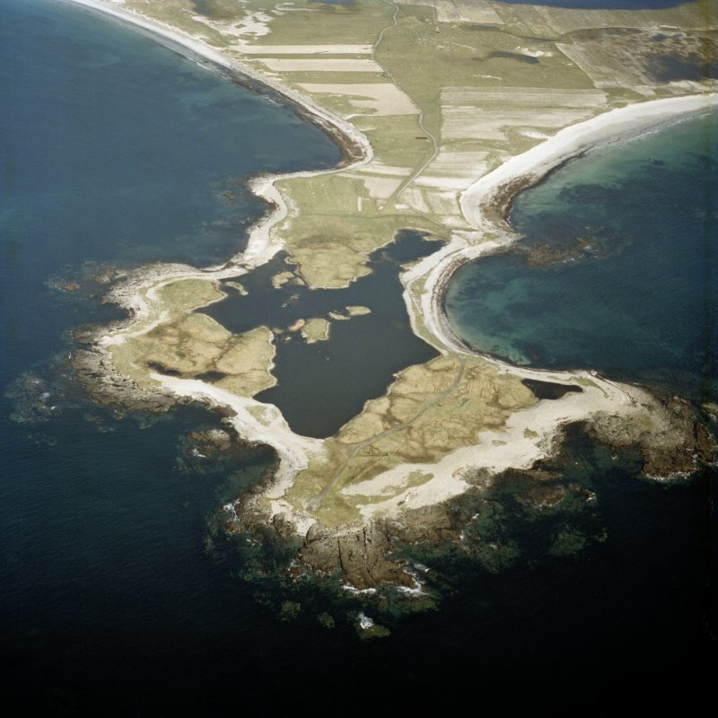 General oblique aerial view looking over Rubhe Ardvule, with the remains of the bothies, kelp kilns and the dun adjacent, taken from the W.