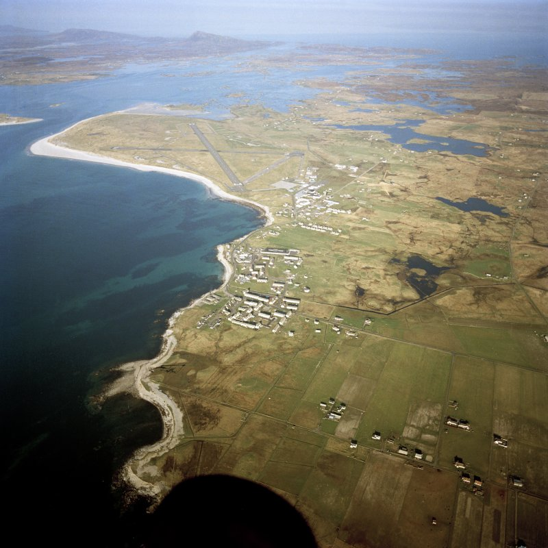 General oblique aerial view looking over Balvanich and Benbecula airport, towards Grimsey in the distance, taken from the W.
