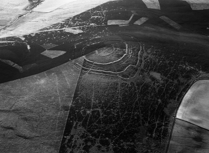 Oblique aerial view centred on the remains of the fort at Brown Caterthun, looking to the NW.