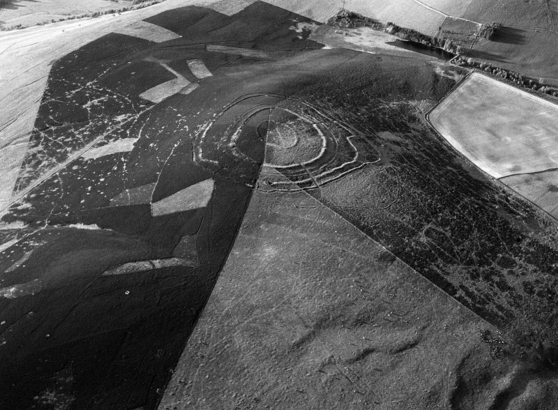Oblique aerial view centred on the remains of the fort at Brown Caterthun, looking to the NNE.