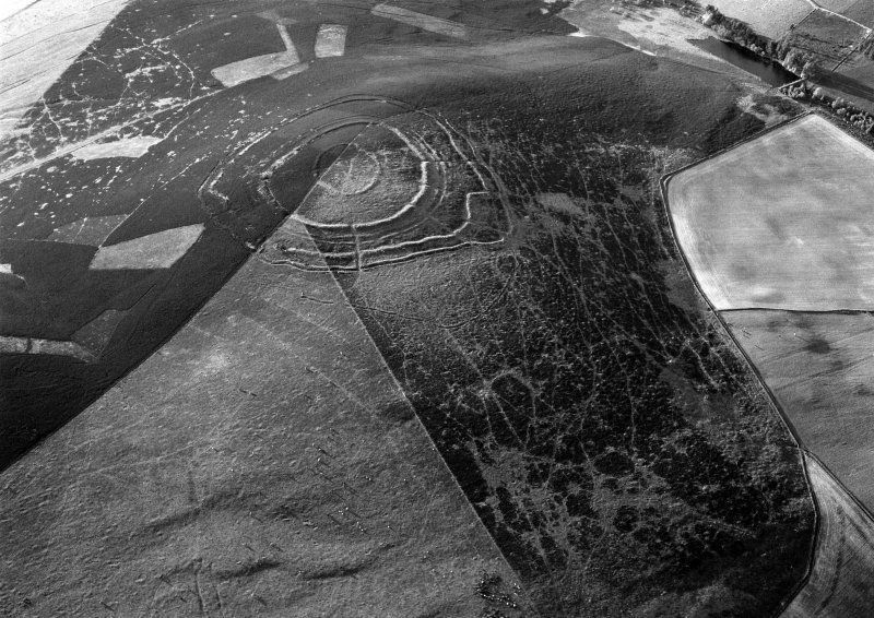Oblique aerial view centred on the remains of the fort at Brown Caterthun, looking to the NNW.