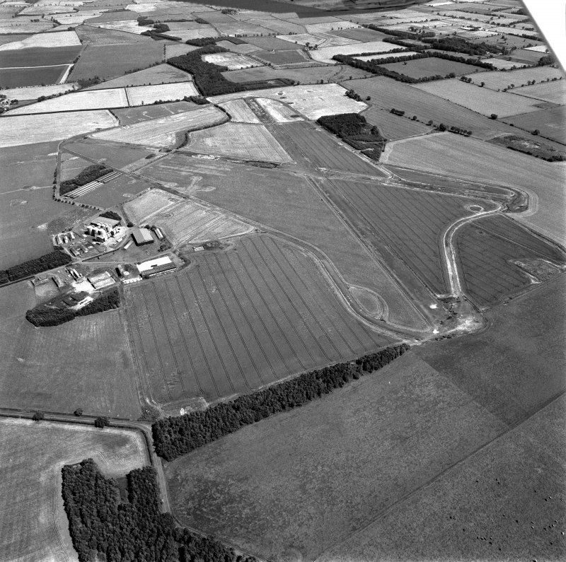 Scanned image of oblique aerial view centred on the airfield, taken from the W.