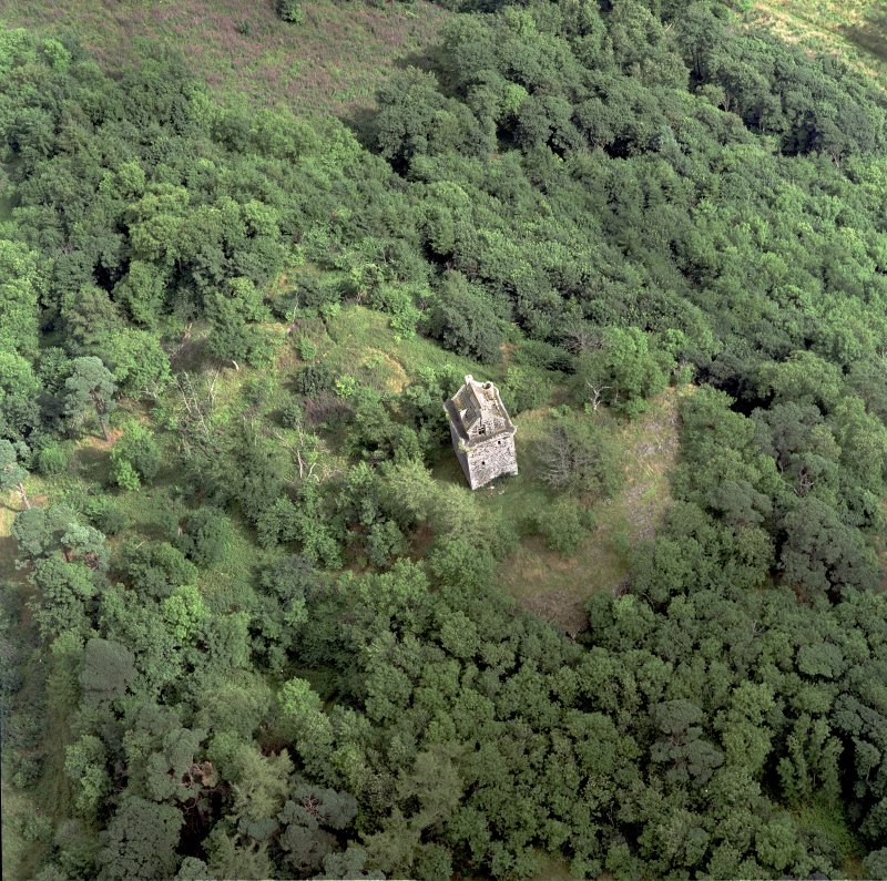 Oblique aerial view centred on the remains of the tower-house, taken from the WSW.