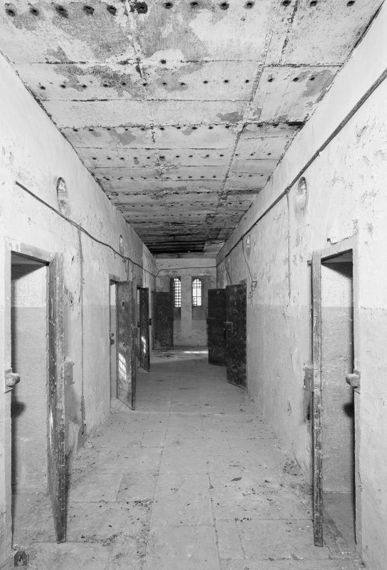 Scanned copy of Interior. W block, first floor, view of corridor.