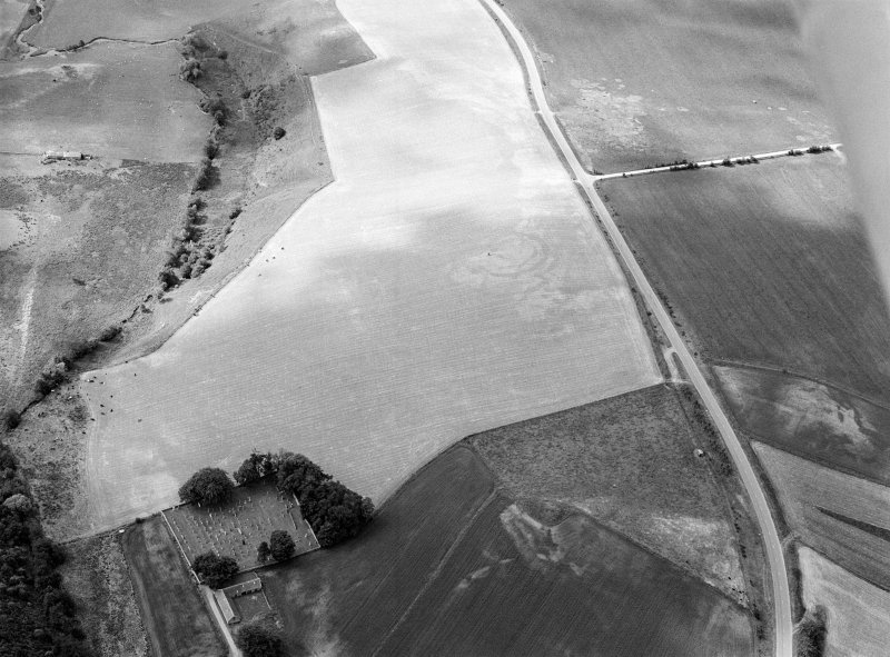 Oblique aerial view centred on the cropmarks of the circular enclosure at Barflat with the cropmarks of the possible square barrows adjacent, looking to the S.