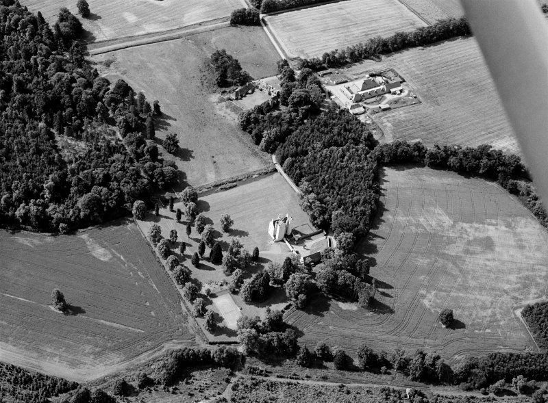 Oblique aerial view centred on Aboyne Castle and Policies, looking to the S.