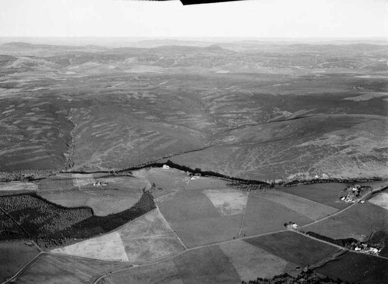 Distant oblique aerial view centred on the remains of Auchindoun Castle and field system, rig and shielings at Allt A'Choileachain, looking to the ESE.