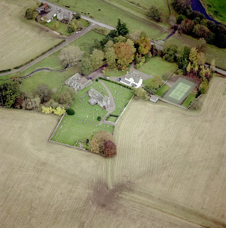 Oblique aerial view centred on the church and house, taken from the WNW.