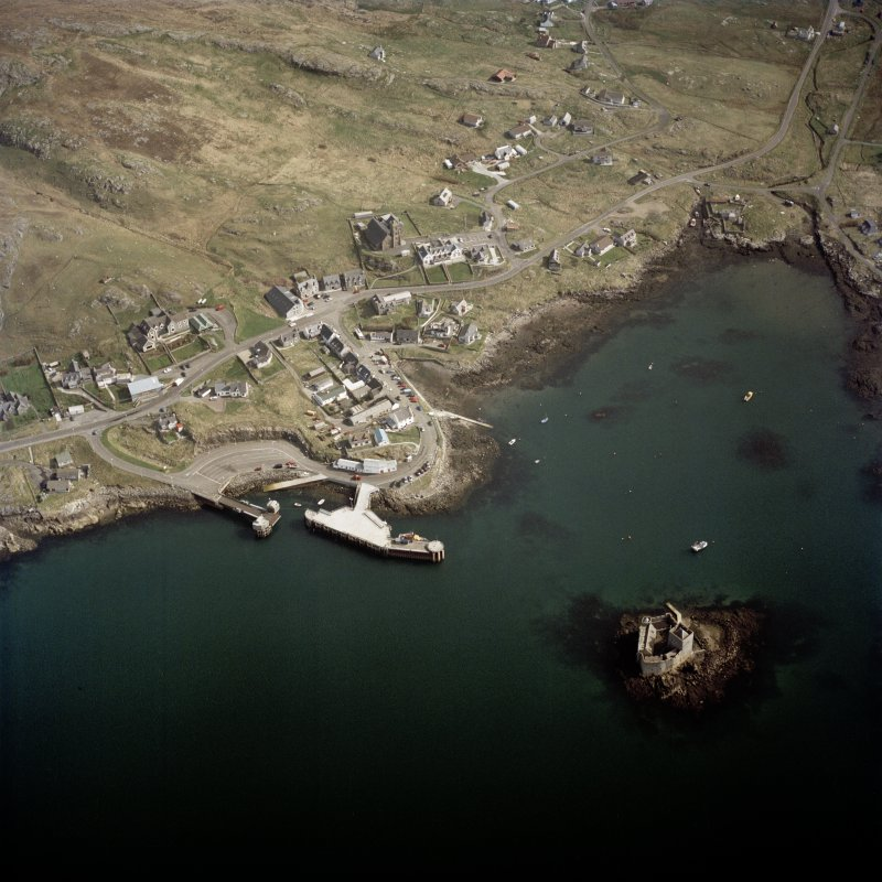 Oblique aerial view centred on the town with the tower-house adjacent, taken from the WSW.