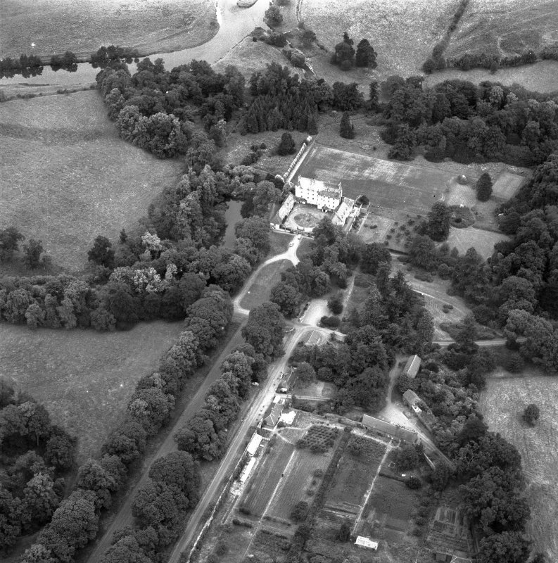 Oblique aerial view centred on Traquair House looking NE.