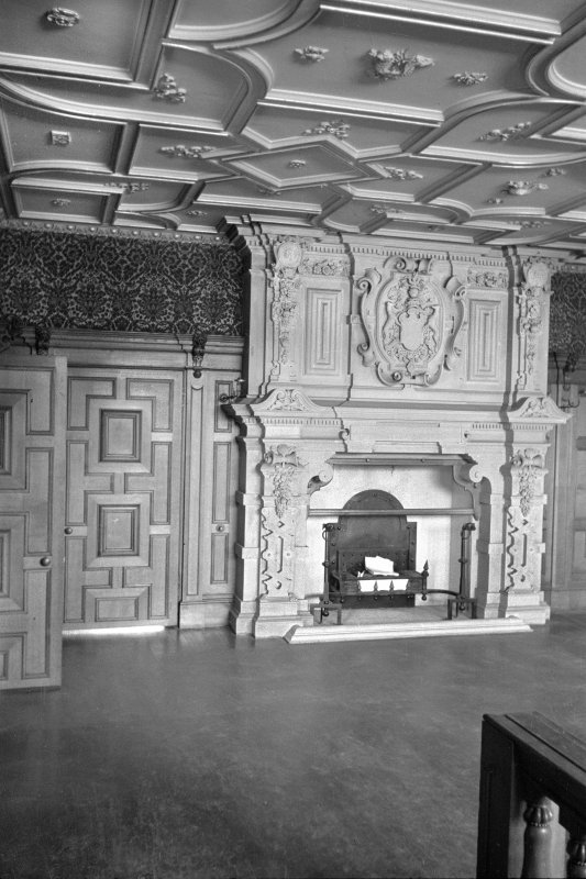 Interior. View of front hall and fireplace.