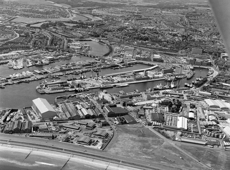 Oblique aerial view centred on Aberdeen harbour and the River Dee, looking to the SW.