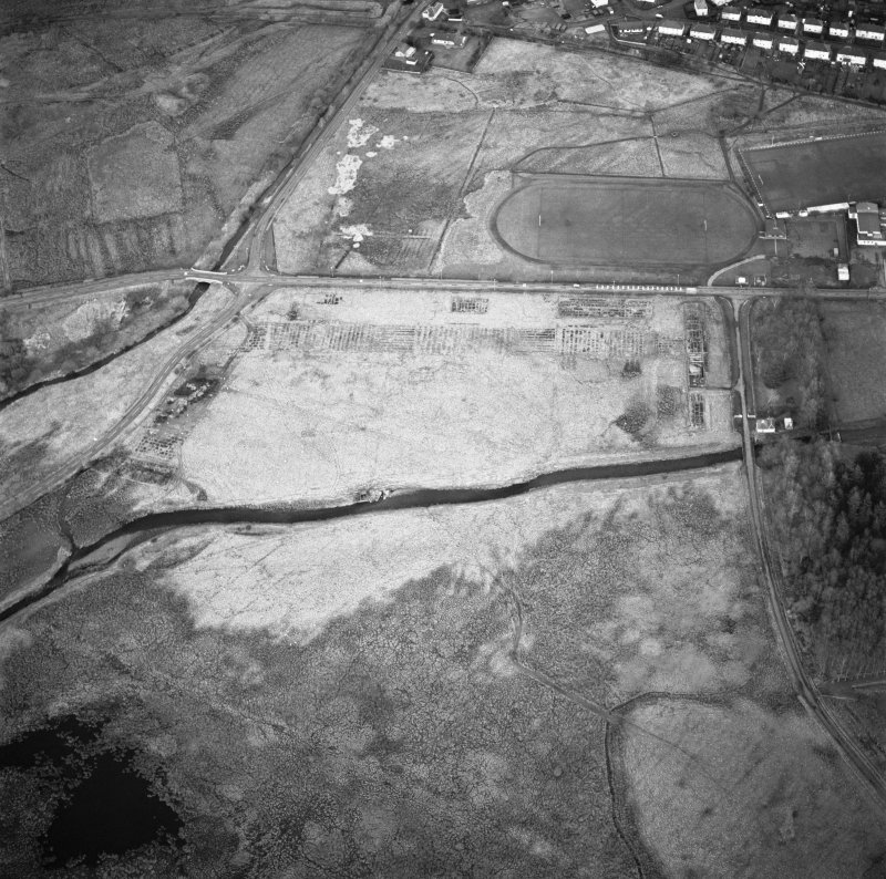 Oblique aerial view centred on the experimental plantation, taken from the SW. Remains of concrete bases for hangers and building of First World War airfield.