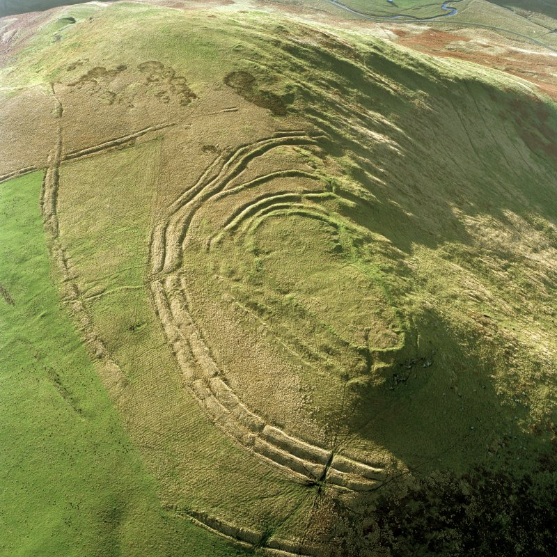 Woden Law, fort and associated monuments: air photograph under conditions of low light. RCAHMS, 1994.