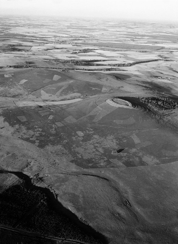 General oblique aerial view centred on the remains of ring ditch houses at White Caterthun, looking to the NNE.