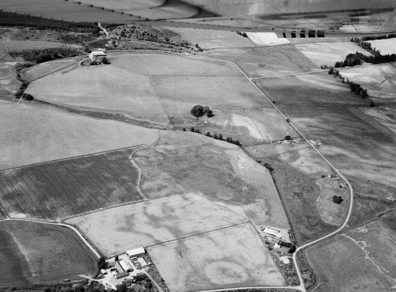 Oblique aerial view centred on cropmarks of geomorphological origin with the site of St Luke's Chapel and well at Clova adjacent, looking to the NW.