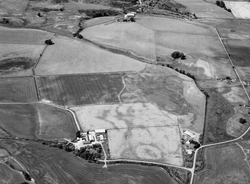 Oblique aerial view centred on cropmarks of geomorphological origin with the site of St Luke's Chapel and well at Clova adjacent, looking to the WNW.