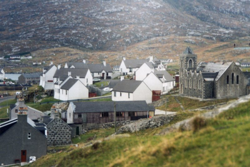 Distant view of church and Ciosmul Cottages.