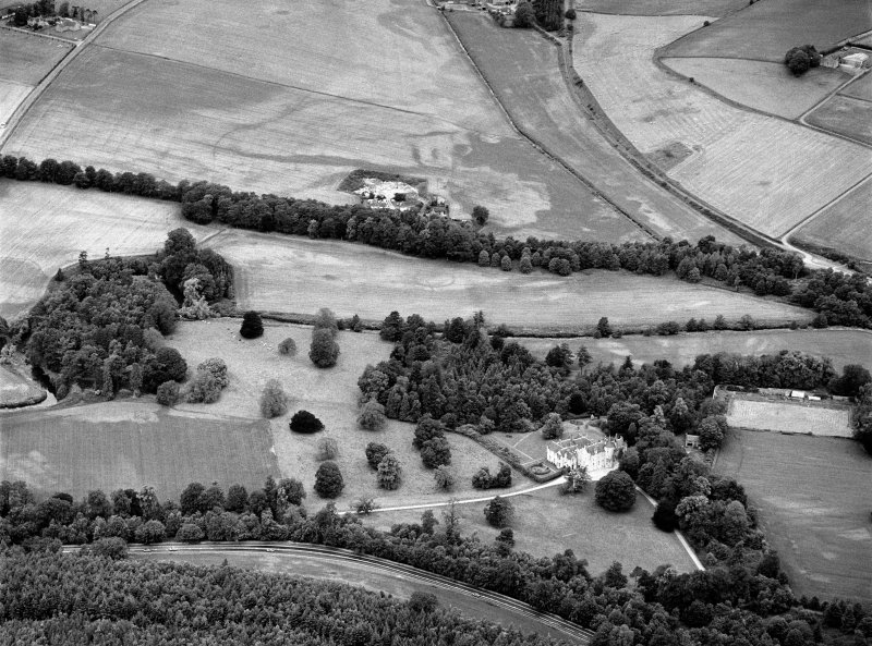 General oblique aerial view centred on Pitcaple Castle with the cropmarks of the enclosure and rig adjacent at Riverbank Wood, looking to the NNW.