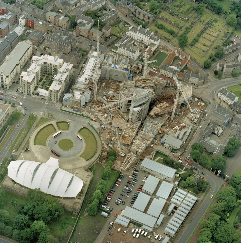 Oblique aerial view centred on the construction of the Scottish Parliament, with 'Our Dynamic Earth' adjacent, taken from the SE.