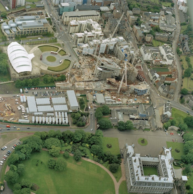 Oblique aerial view centred on the construction of the Scottish Parliament, with 'Our Dynamic Earth' adjacent, taken from the ENE.